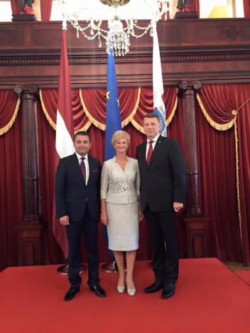Hosam Abu Merhi with President Raimonds Vejonis and first lady Iveta Vejone.jpg